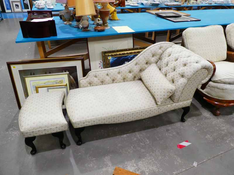 A modern Victorian style chaise lounge with matching cushion and footstool