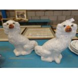 A pair of staffordshire pottery fireside dogs