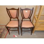 A pair of Edwardian inlaid shield back bedroom chairs
