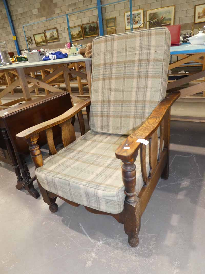 A William Morris inspired oak framed reclining chair with cushion seat and back