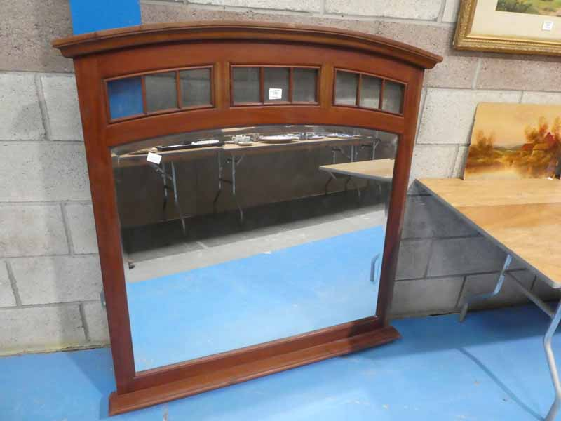 A large arch top overmantle mirror with gloss frieze above large bevelled glass mirror