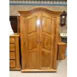 A fruitwood armoire, two door with three interior shelves