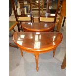 A small pair of Regency style Yew wood and crossbanded D shape occasional tables on three turned/
