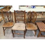 A pair of 19th Century wheel back Windsor chairs and a Yorkshire spindle back rush seat chair