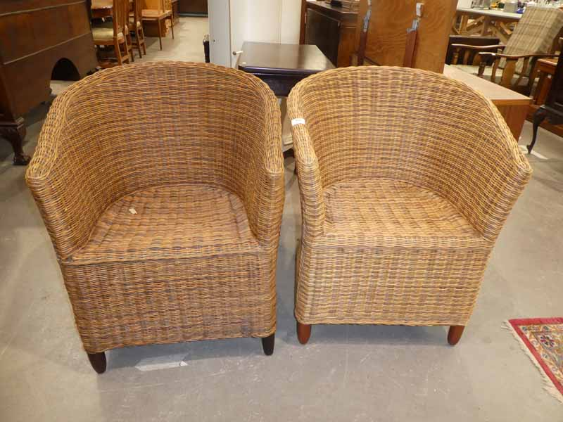 A pair of wicker conservatory chairs