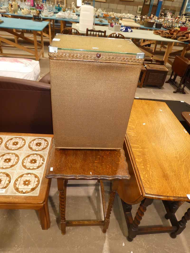 A woven bedroom linen Box and oak rectangular window table