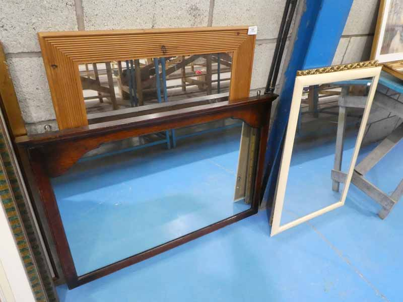 An oak framed over mantle mirror, a pine framed wall mirror and two others