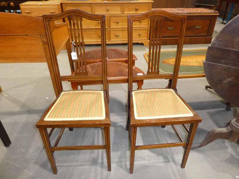 A pair of Edwardian mahogany Bedroom Chairs