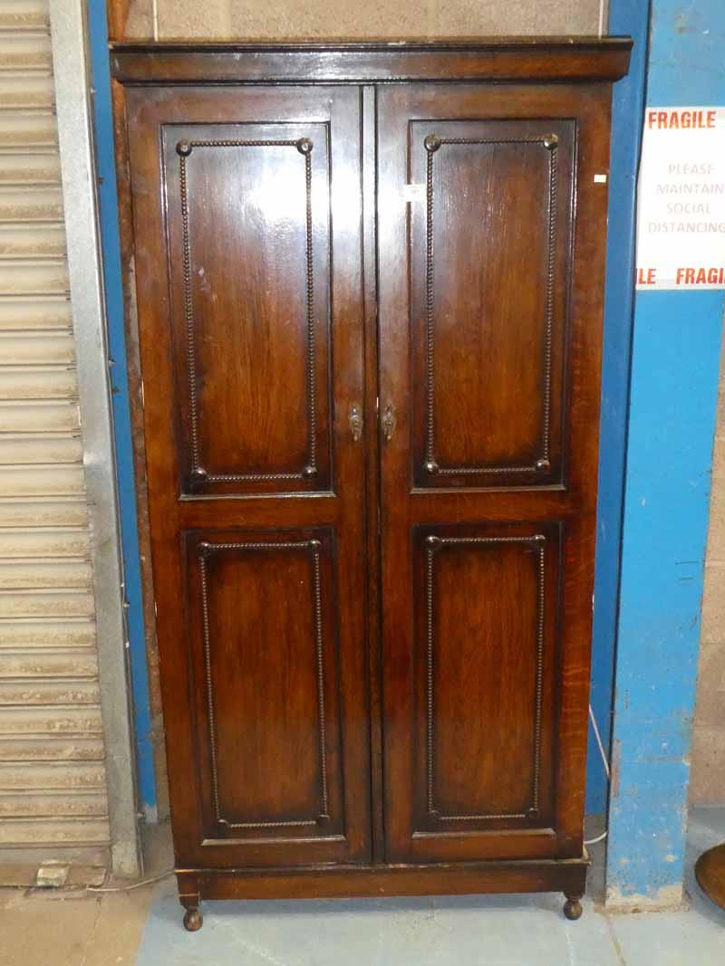 A 1930's oak single wardrobe with twin doors