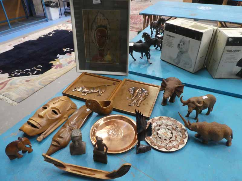 Sixteen items of African souvenirware to include treen, copper, carved masks