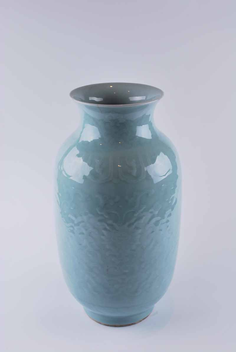 A Chinese celadon glazed vase, baluster form with everted neck decorated in low relief with lotus - Image 2 of 4