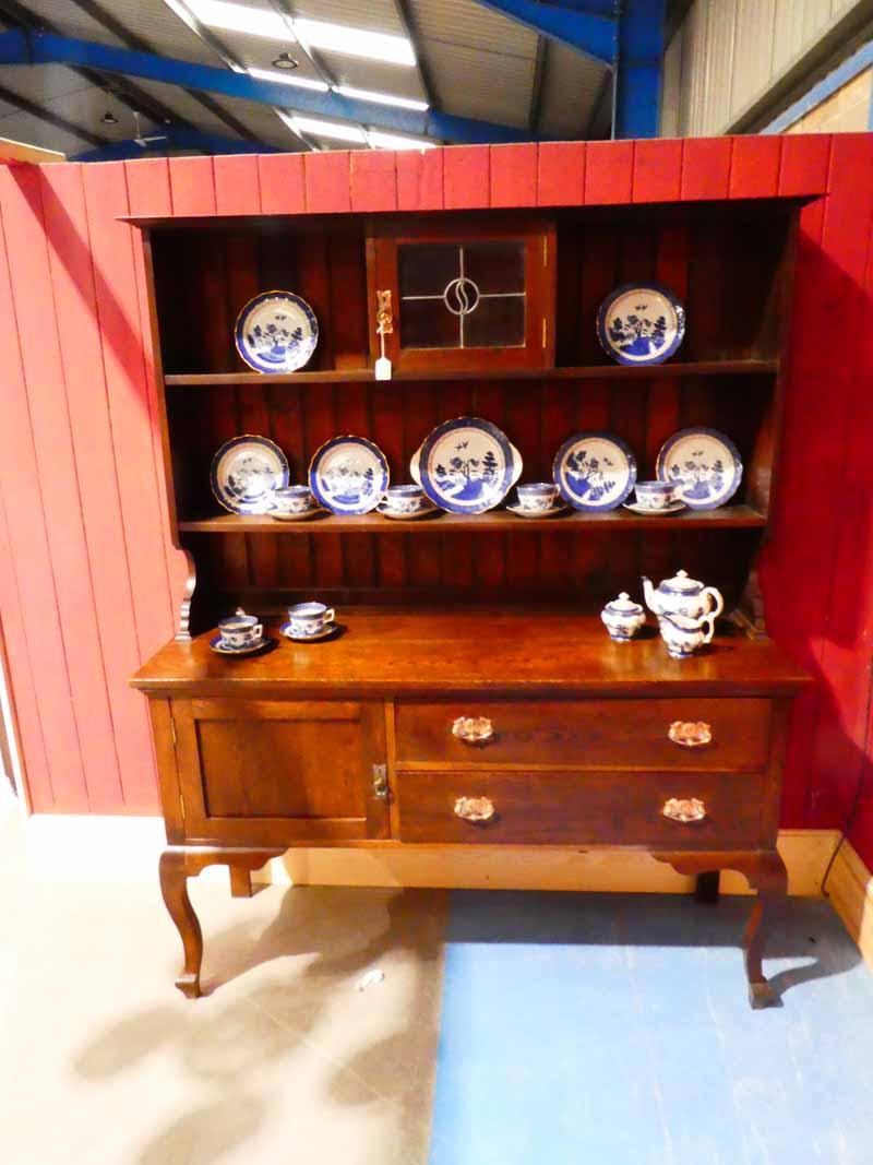 An oak Craft Dresser, the shallow rectangular moulded cornice above a shelved boarded display back - Image 3 of 3