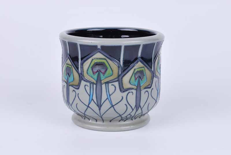 A Moorcroft small footed planter in the Peacock Parade pattern by Nicola Slaney, dated 2012 to the