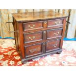 A Georgian oak chest of three graduated drawers with panel sides and applied wrought iron rails 86cm