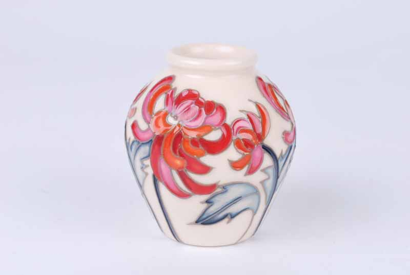 A Moorcroft miniature Chrsanthemum vase representing November in the Floral Months series from