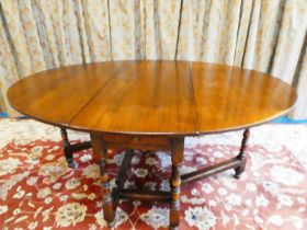 A handmade Titchmarsh & Goodwin drop leaf gateleg dining table