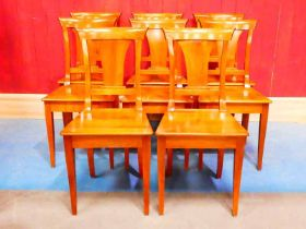 A set of eight walnut Biedermeier dining chairs with flared splat 90cm H
