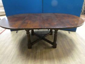 Mid century handmade oak two leaf draw action table in an earlier style length 214cm