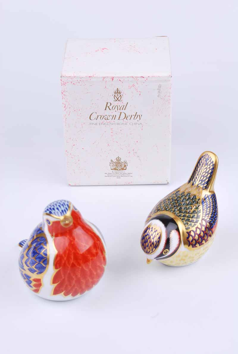 A Royal Crown Derby robin paperweight together with a further bluetit example (2)