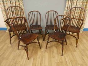 Six reproduction hand made Windsor chairs with elm seats and crinoline stretchers. Four chairs and 2