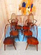 A set of eight Ercol arch back Windsor chairs
