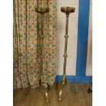A fine pair of puginesque brass candlesticks standing on trefoil feet at 120cm H