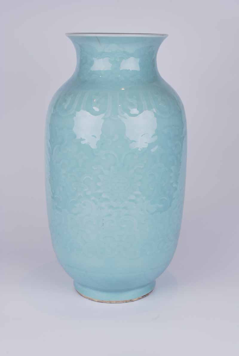 A Chinese celadon glazed vase, baluster form with everted neck decorated in low relief with lotus - Image 3 of 4