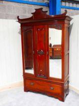 A Victorian mahogany single wardrobe with later pagoda top