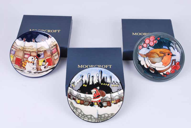 Three Moorcroft pin dishes,in Chistmas themes, all boxed and with four Moorcroft carrier bags (7)