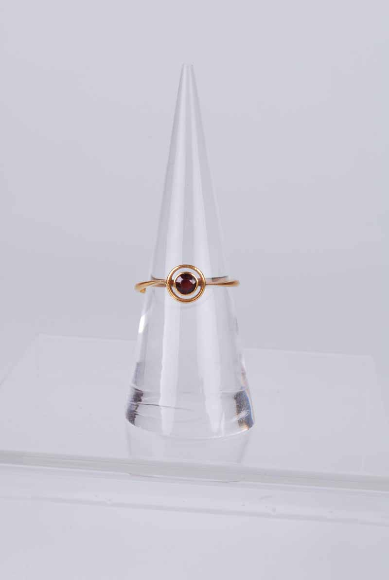 A 22 ct gold rub over set ruby target ring, size N 1/2, 2.1 g
