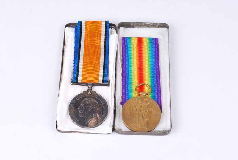 Great war pair of service and defence medals inscribed 76901 pte W.H Houghton Manch. R. With