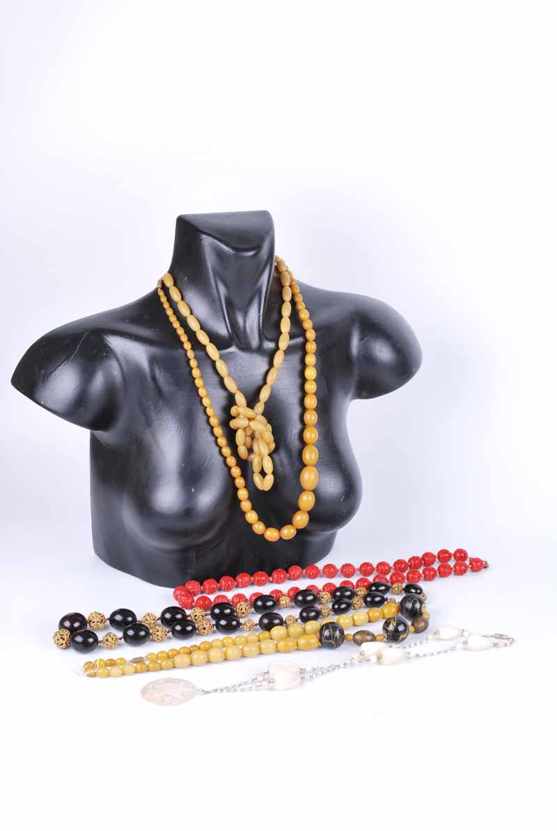 A dark cherry amber style and metal bead necklace 64 cm L, a cinnabar lacquer necklace 67 cm L,