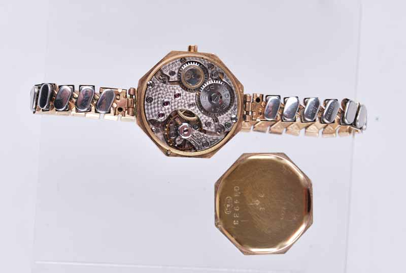 Rolex - a vintage 1930s lady's octagonal 9ct gold wristwatch, the silvered dial with Arabic