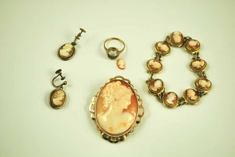 A suite of shell cameo jewellery including an 800 grade silver gilt bracelet, a 9 ct gold mounted
