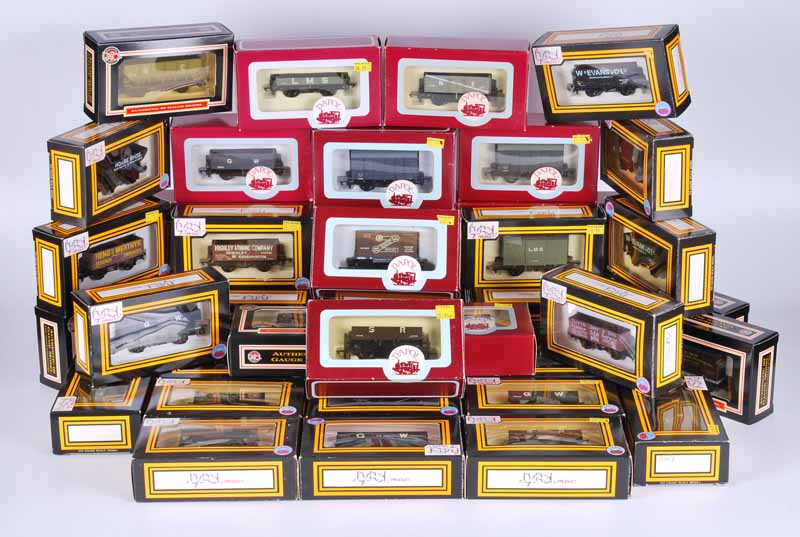 Collection of 39 Dapol railway goods wagons boxed including open plank box van, open plank rock