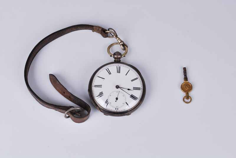 1862 silver cased open face pocket watch, white face, seconds dial with key