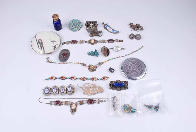 A group of silver filigree items including a matching sword brooch and bracelet set with enamel