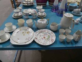 Two white and gilt part tea service and three odd plates.