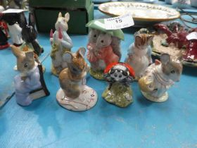 Eight Royal Albert Beatrix Potter figures all in pale blue boxes.