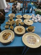 A large Poole Pottery table service in the Thistlewood design.