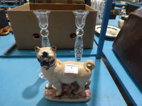 Pair of lead crystal candlesticks and a pottery staffordshire style pug dog.