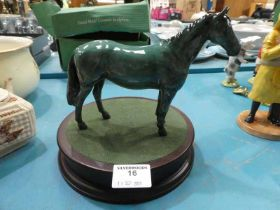 A Beswick stallion in rare green glaze and a circular plinth.