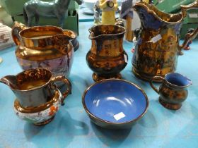 Five copper lustre jugs including Sunderland and one bowl