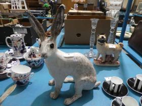 A large Winstanley pottery model hare size 9 with glass eyes.