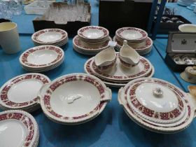 A Johnson Brothers Part dinner service in cream with red / gilt border