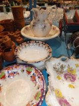 Pottery jug and bowl and four Victorian plates.