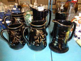 Six items of Jackfield pottery jugs