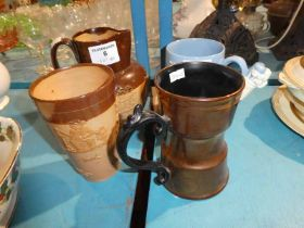A Beswick copper lustre Tankard, A Doulton jug and beaker in part treacle glaze, and an early