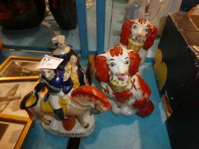 A pair of Staffordshire style dogs and two repro flat-back figures