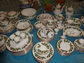 An extensive Christmas dinner service by Royal Grafton, white and gilt decorated with holly sprigs